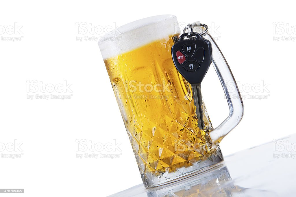Glass of beer and car keys stock photo