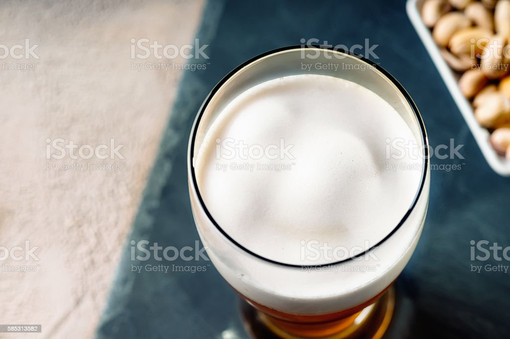 Glass of beer and pistachio nuts stock photo