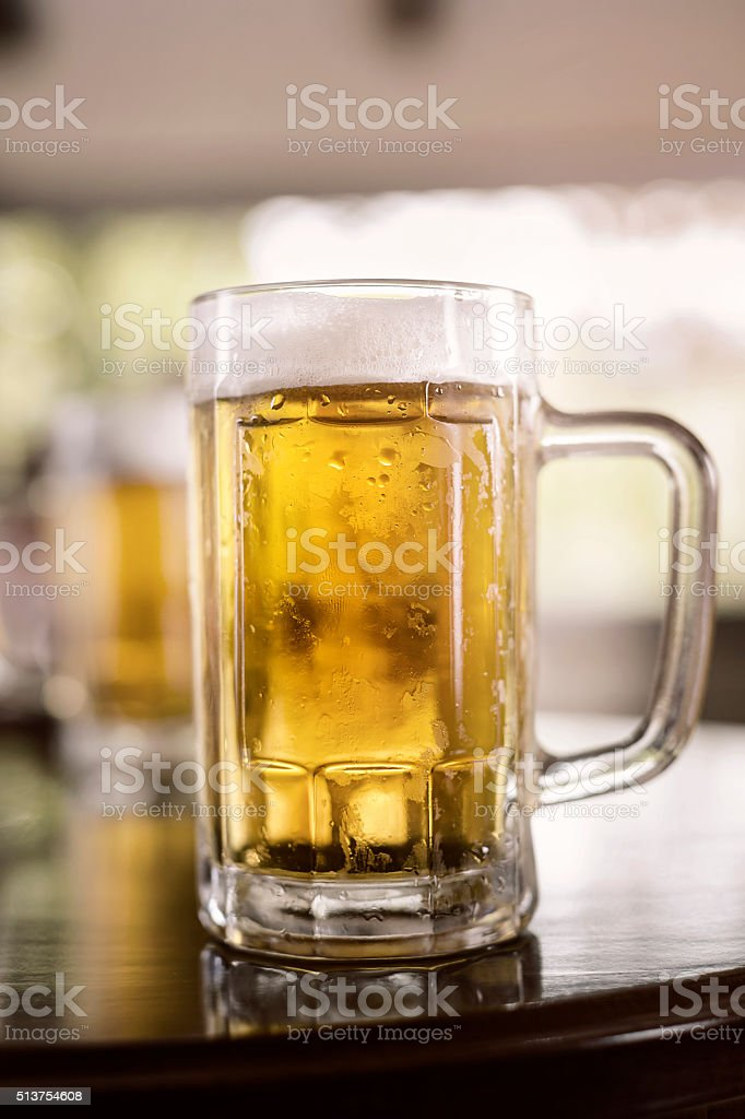 Glass of beer in a pub stock photo