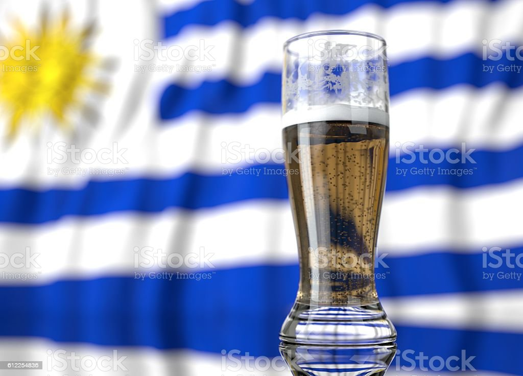glass of beer in front a Uruguayan flag stock photo