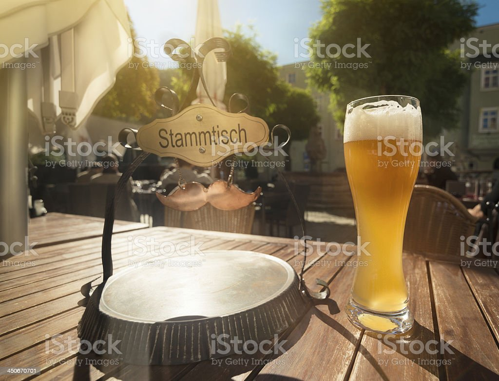 A glass of beer on an outdoor table stock photo