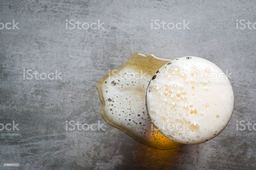Glass of beer on the table stock photo