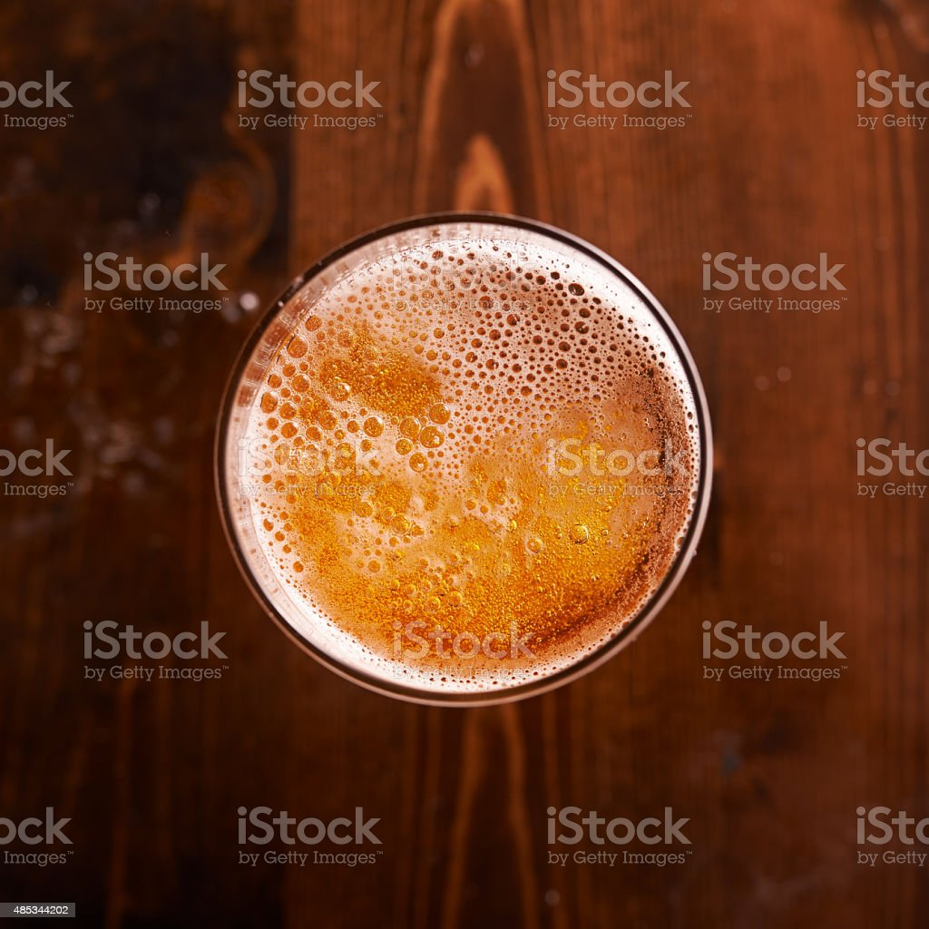 glass of beer shot top down stock photo