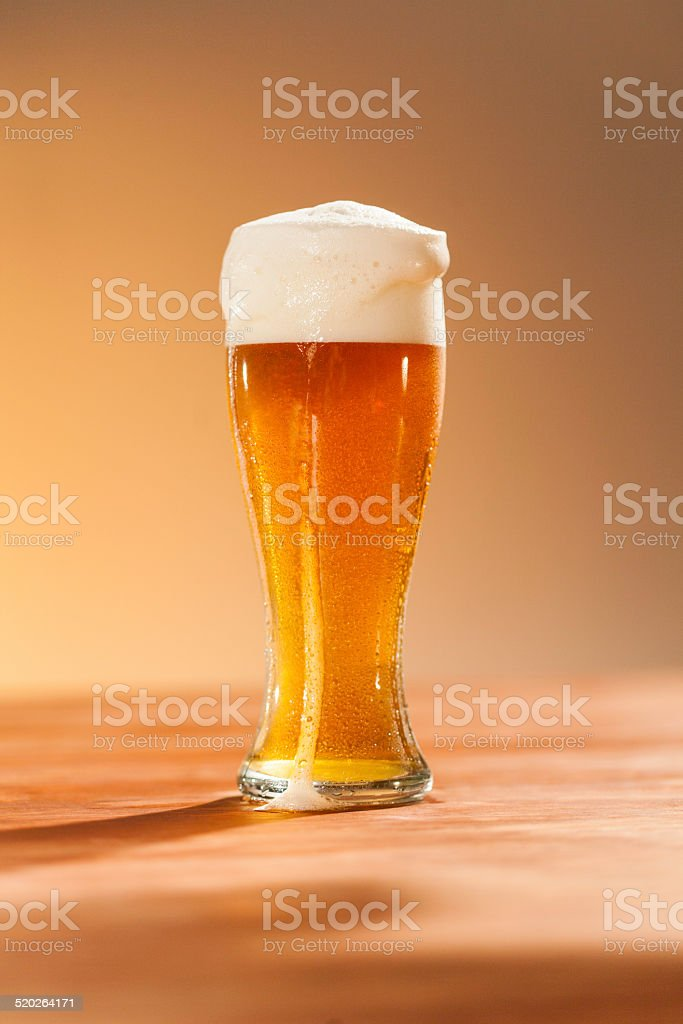 Glass of beer standing on the table stock photo