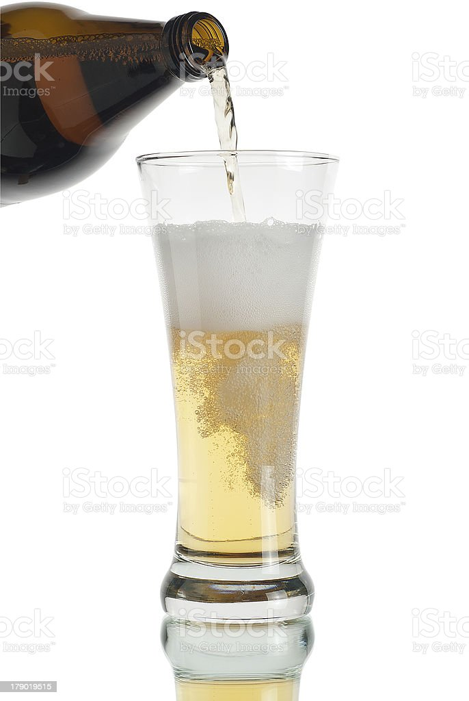 glass of beer with a bottle royalty-free stock photo