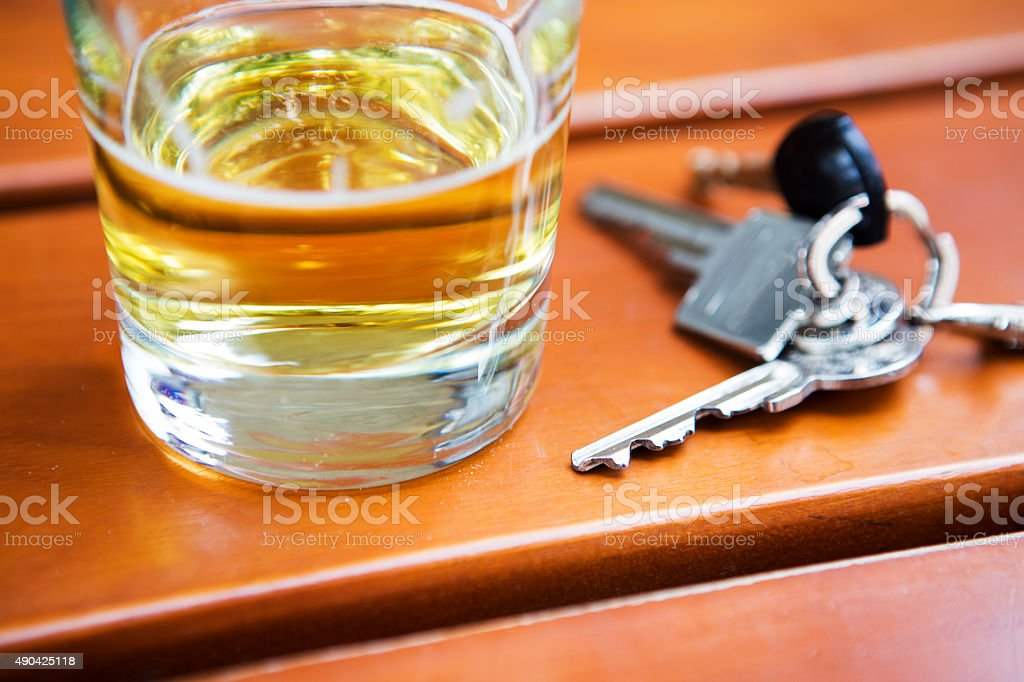 glass of beer with key stock photo