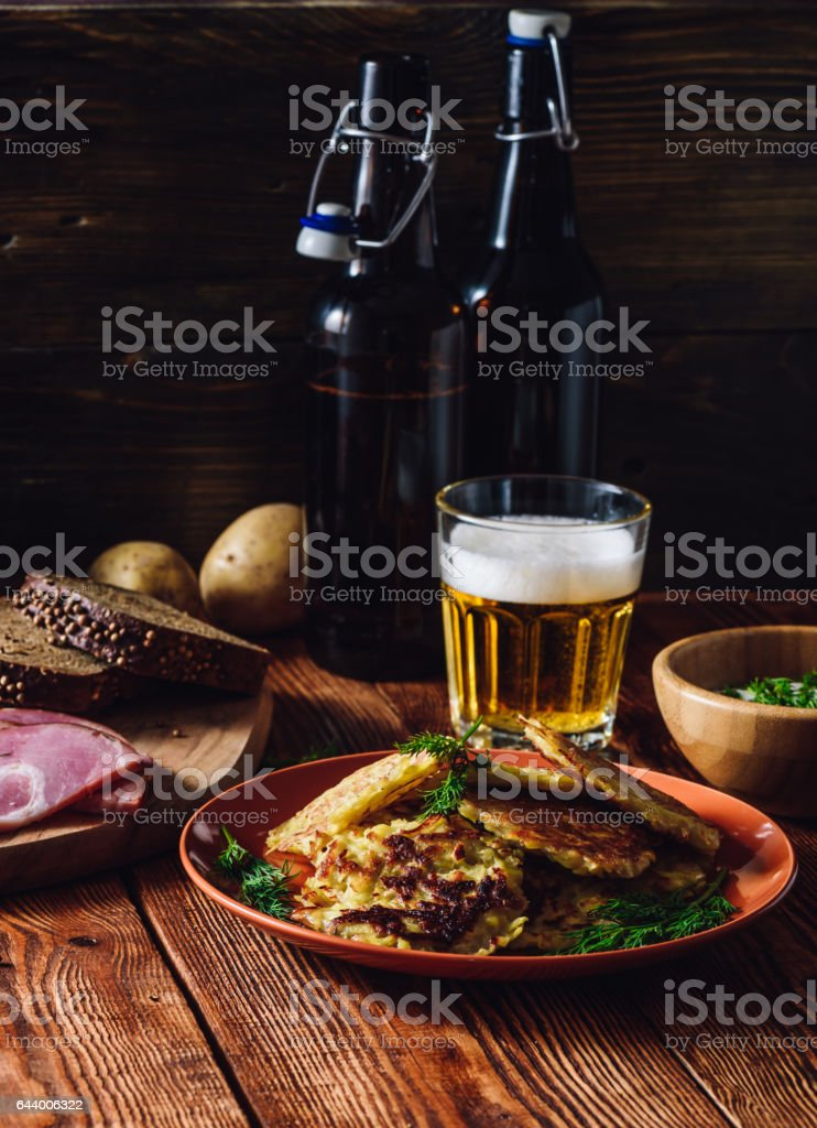 Glass of Beer with Potato Pancakes stock photo