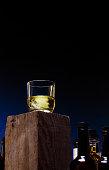Glass of Bourbon Whiskey on Wood Block