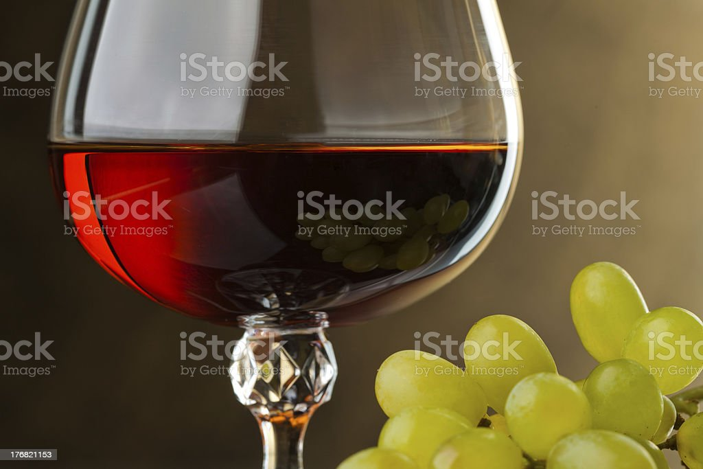 Glass of brandy and grape. Detail royalty-free stock photo