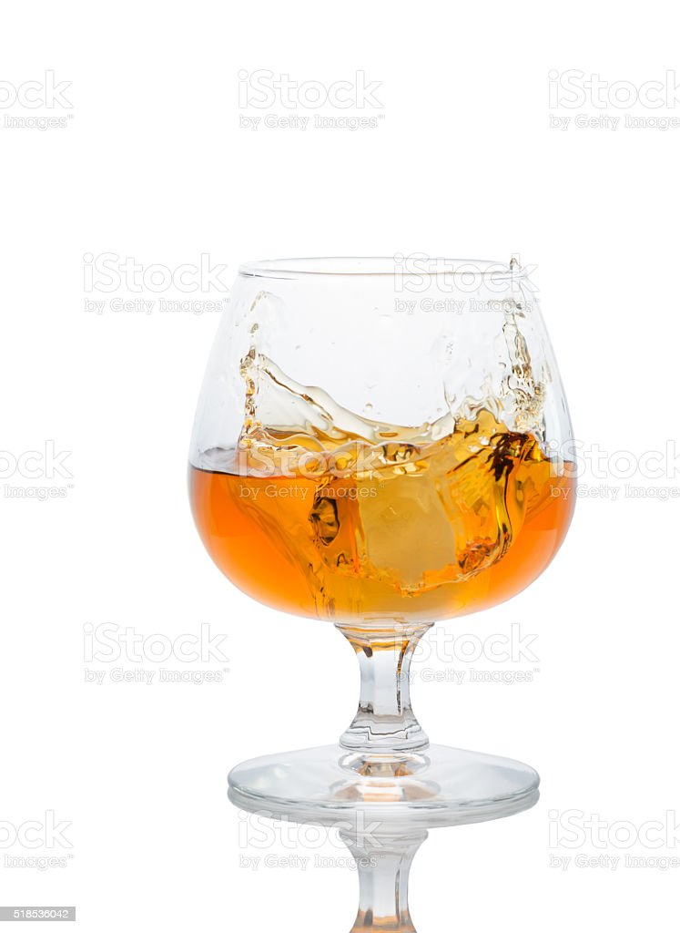 glass of brandy on a white background. stock photo