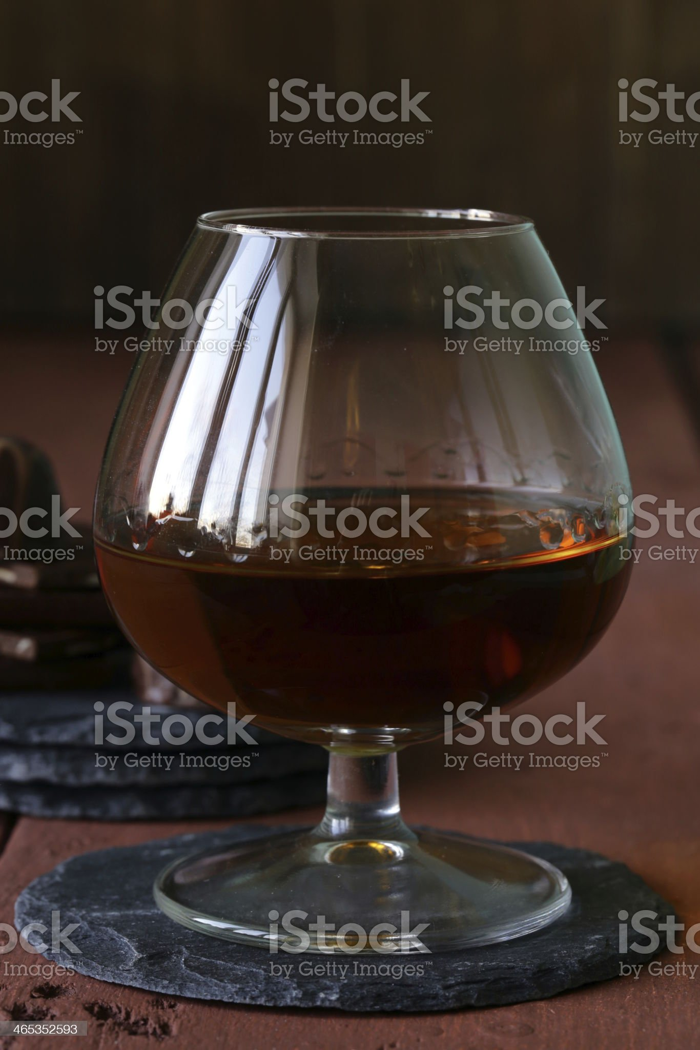 glass of brandy with chocolate on wooden table royalty-free stock photo