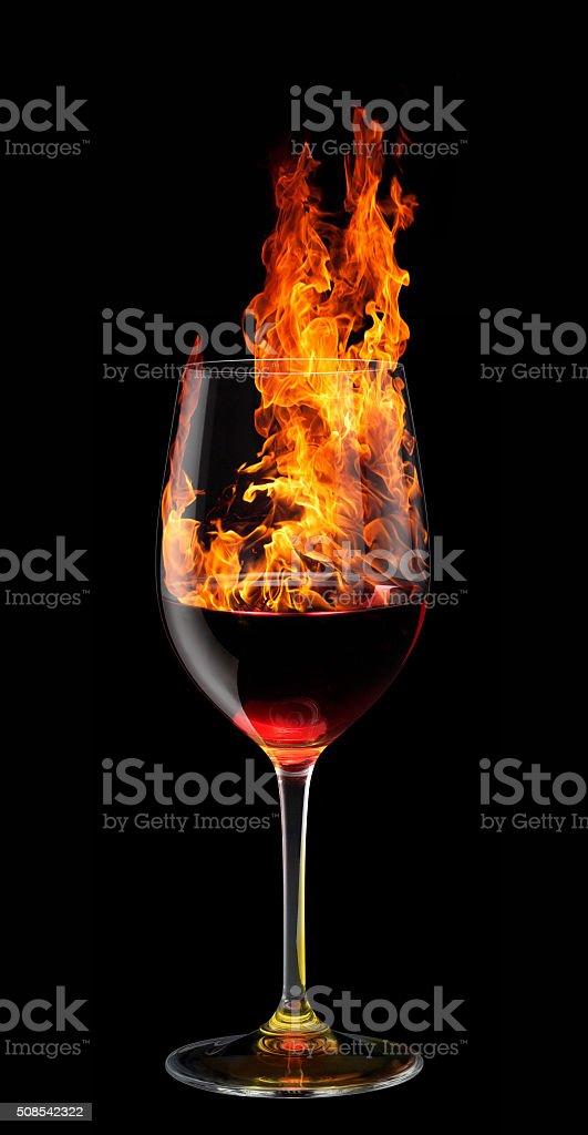 glass of burning red wine stock photo