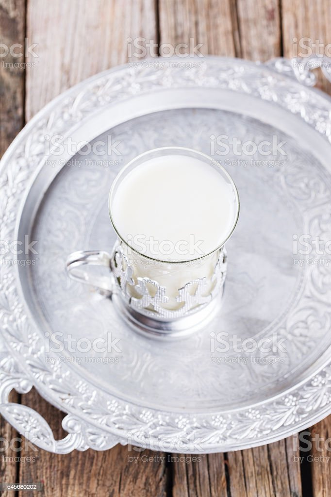 glass of buttermilk and a bunch stock photo