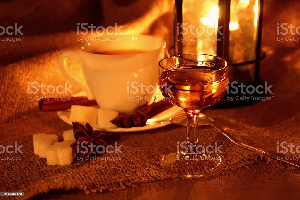 Glass of Calvados and a cup of coffee. stock photo