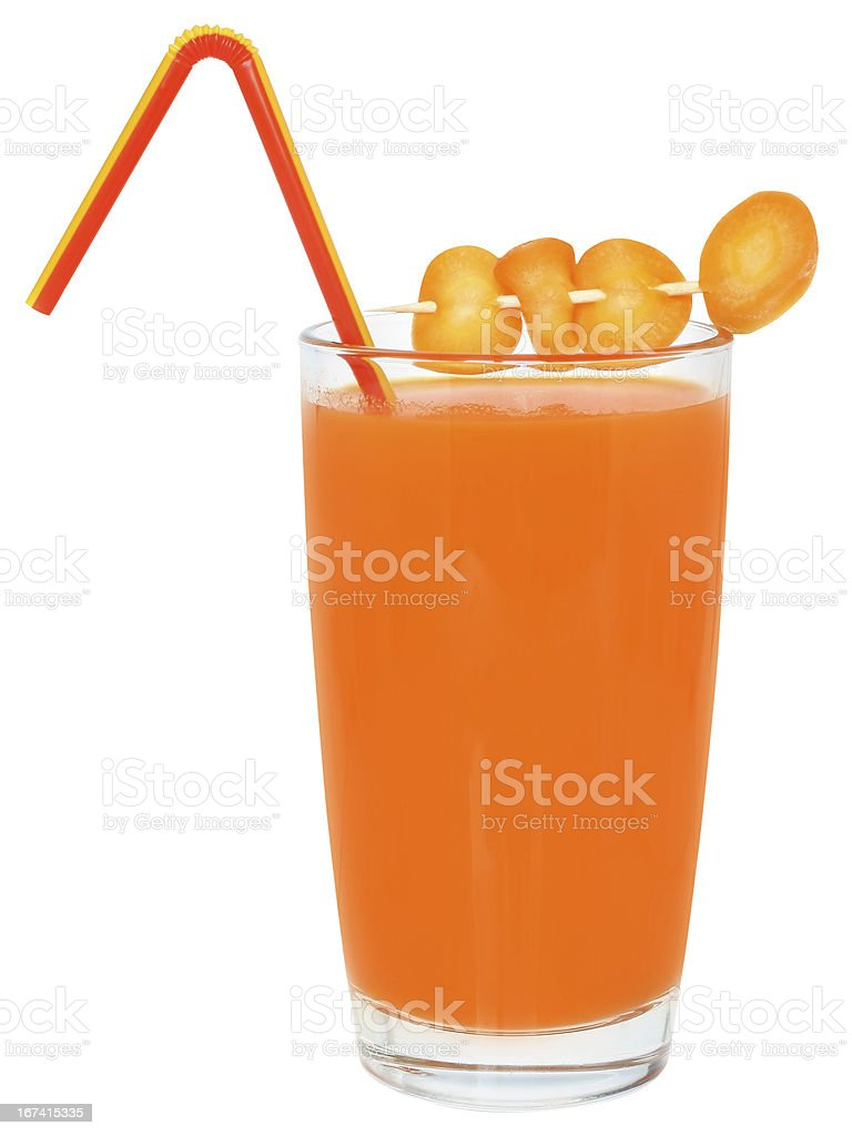 Glass of carrot juice decorated sliced carrots. stock photo