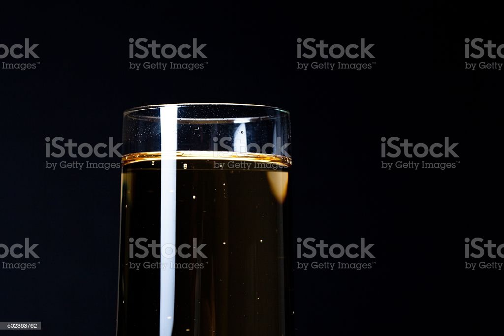 glass of champagne against black background stock photo