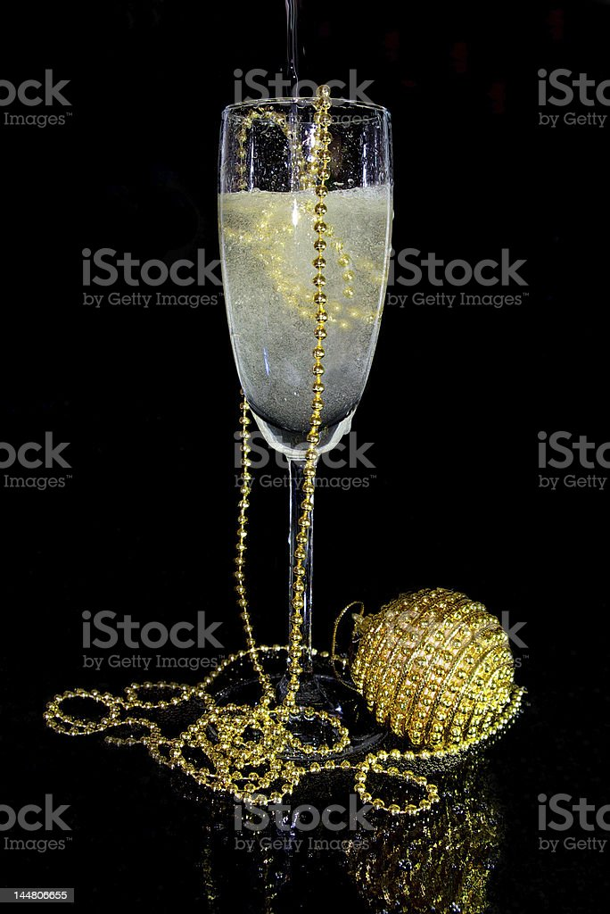 glass of champagne and christmas decoration stock photo