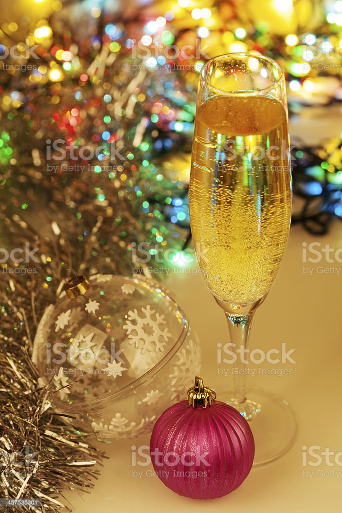 Glass of champagne and christmas decorations on festive background royalty-free stock photo