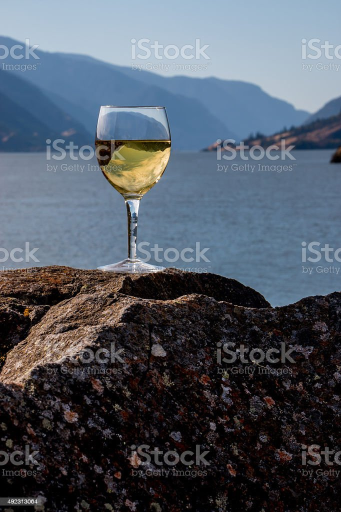 Glass of Chardonnay Wine Inverting Columbia River Gorge Oregon Washington stock photo