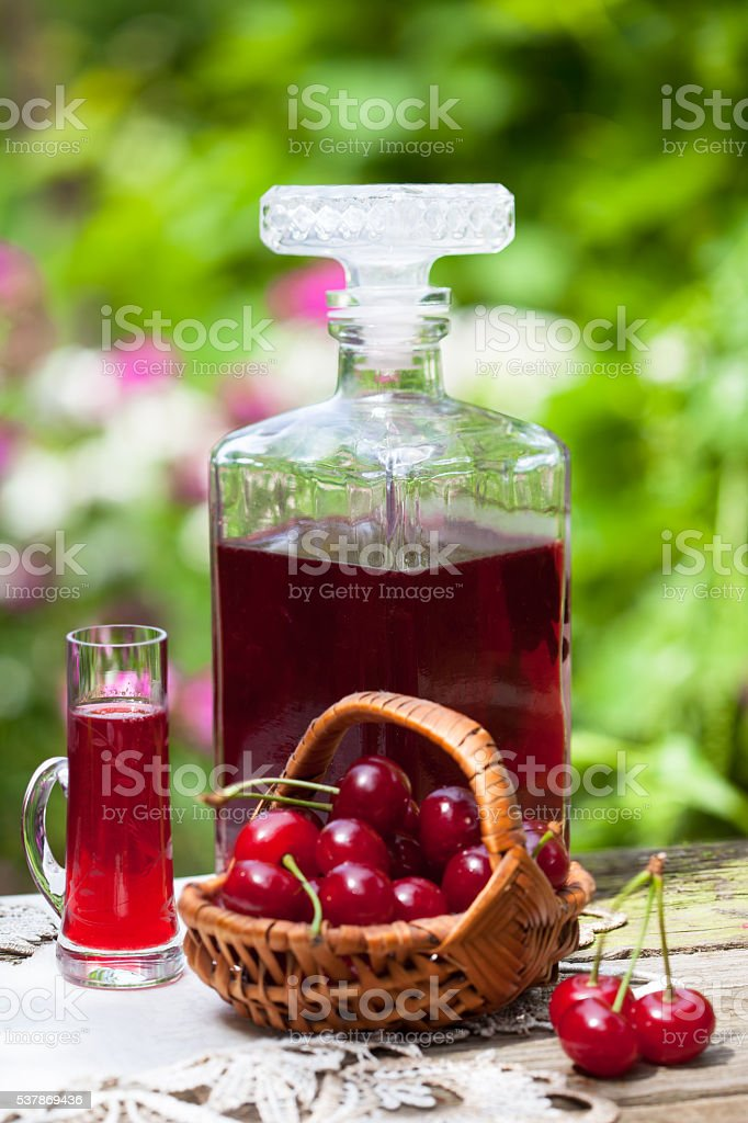 Glass of cherry brandy liqueur stock photo
