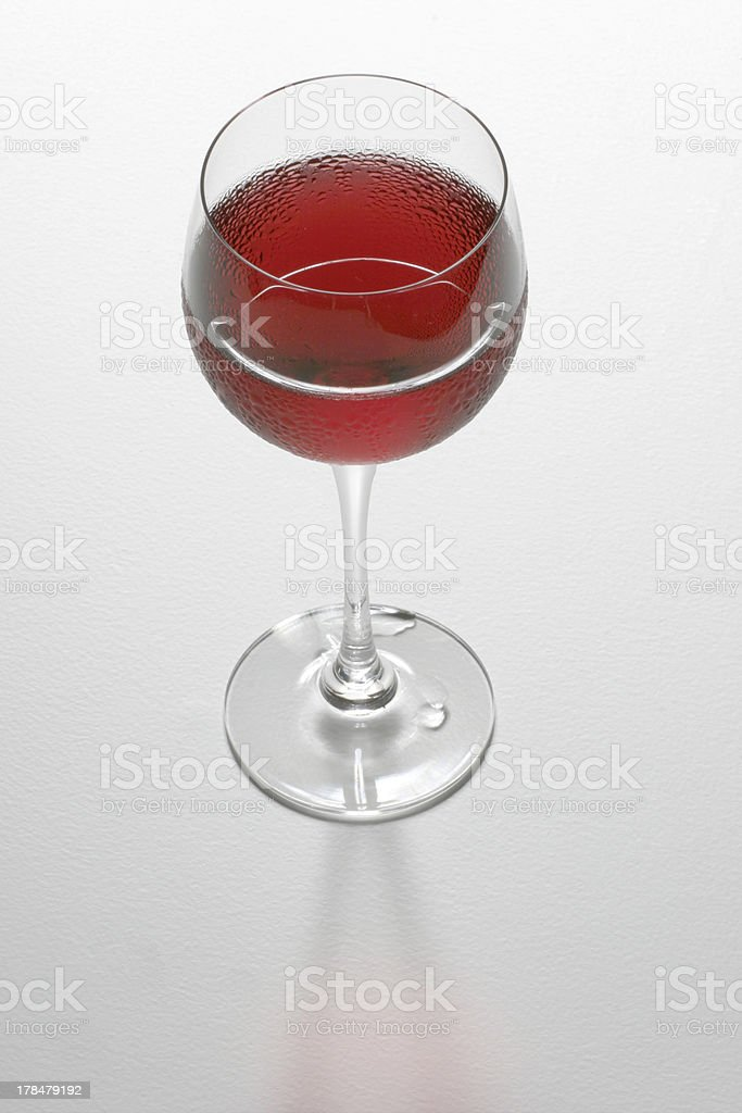 Glass of chilled rose wine on a white bakground stock photo