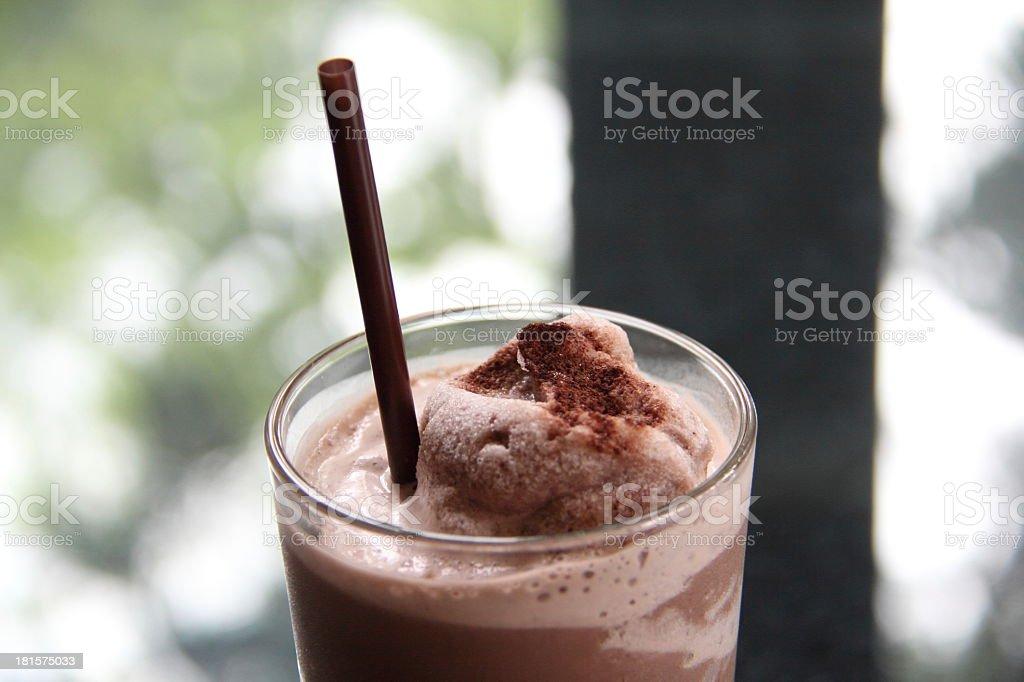 Glass of chocolate milkshake with cinnamon garnish stock photo