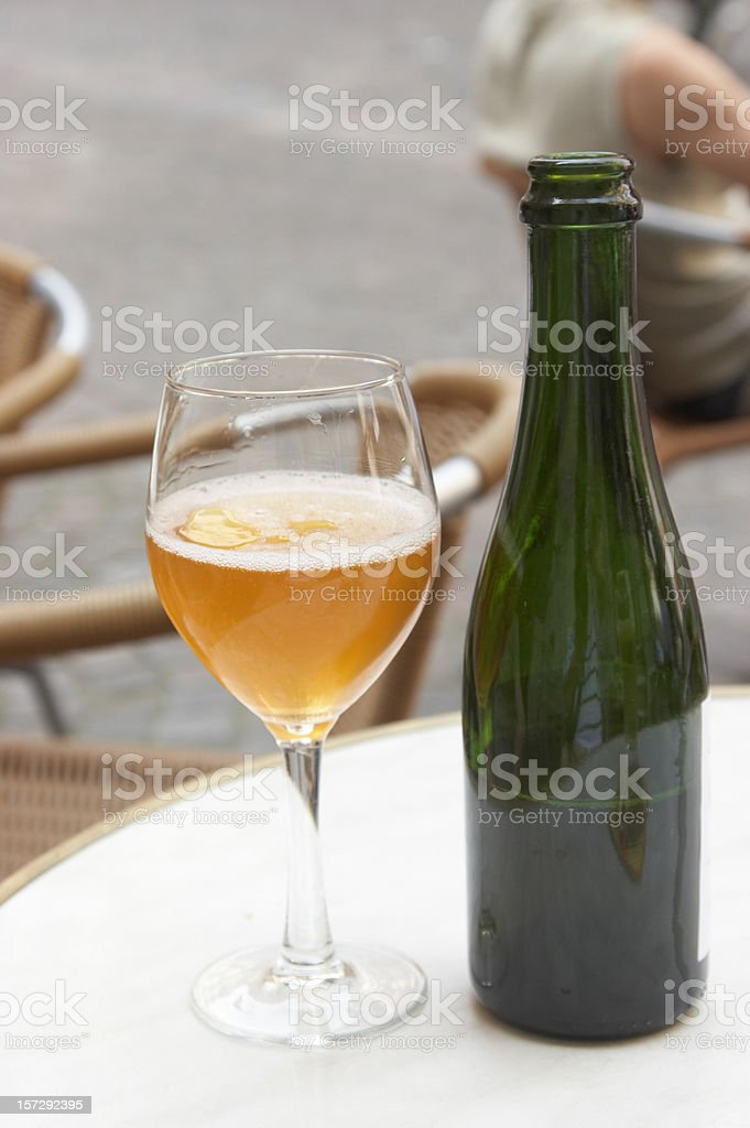 Glass of cider with bottle royalty-free stock photo
