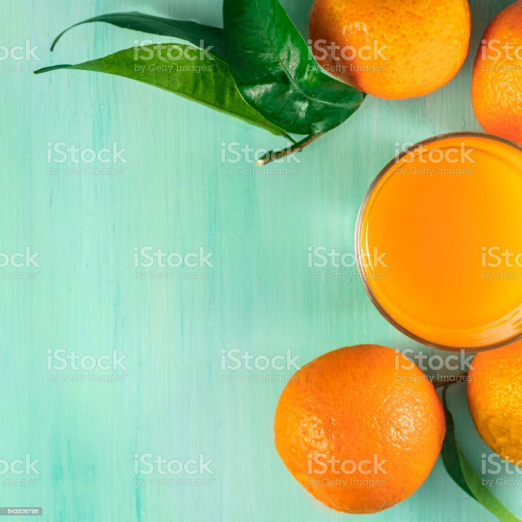 Glass of citrus juice with tangerines and copyspace stock photo