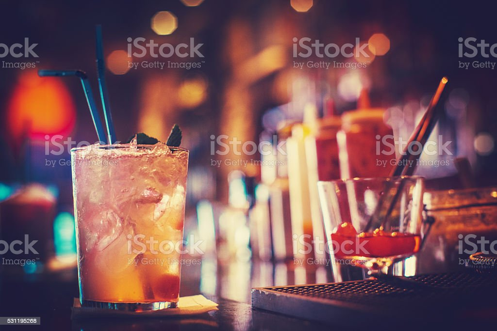 Glass of cocktail served on the bar stock photo