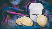 glass of coffee and cookies on a colored background, a