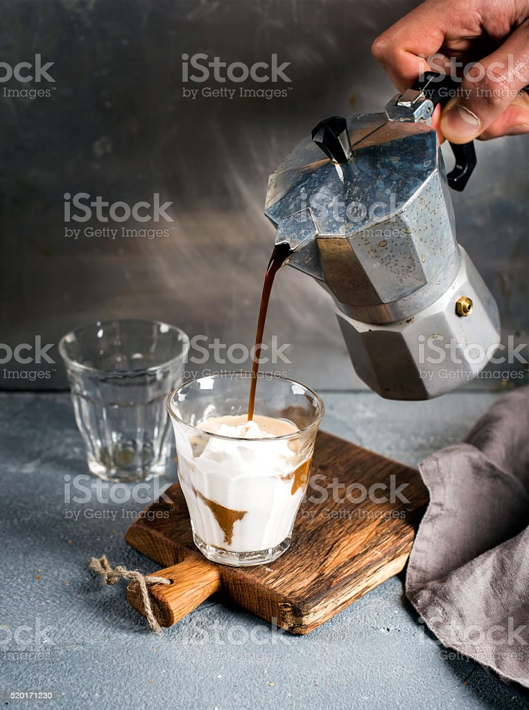 Glass of coffee with ice cream on rustic wooden board stock photo
