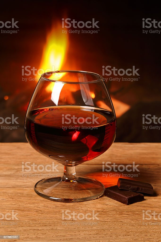 Glass of cognac and chocolate stock photo