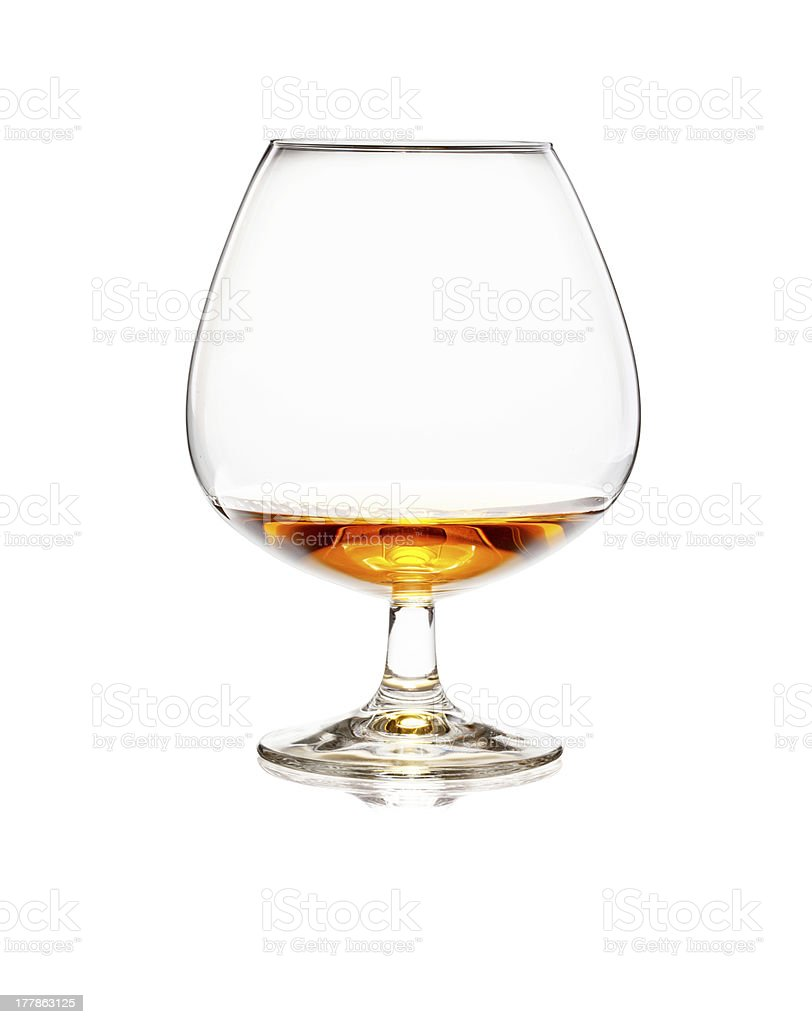 Glass of cognac or whiskey isolated on white background royalty-free stock photo