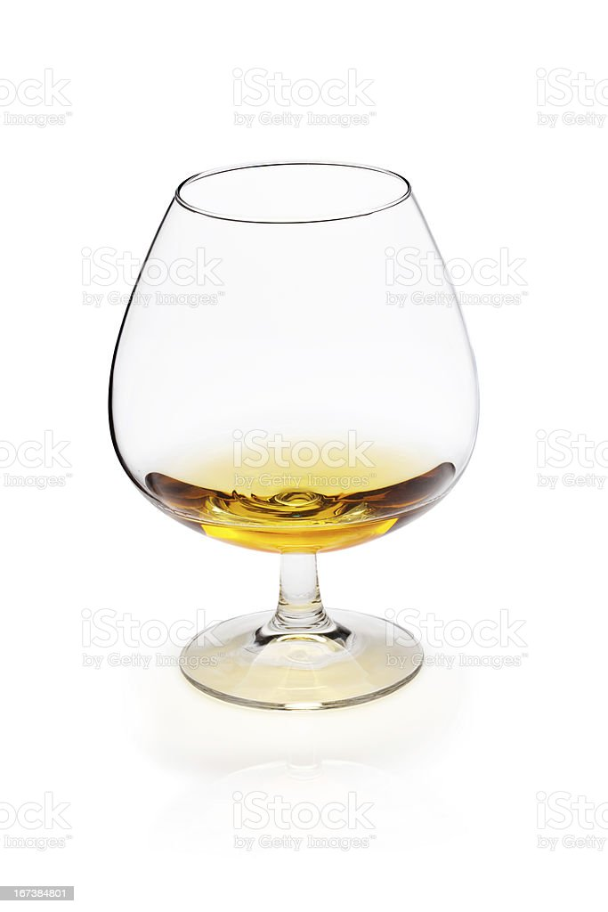 Glass of cognac or whiskey on white royalty-free stock photo