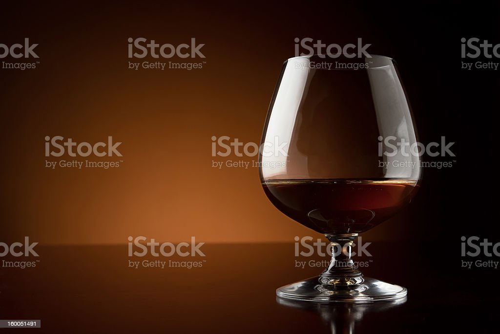 Glass of cognac with copy space stock photo