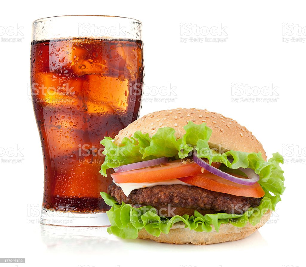 Glass of cola with ice and hamburger royalty-free stock photo