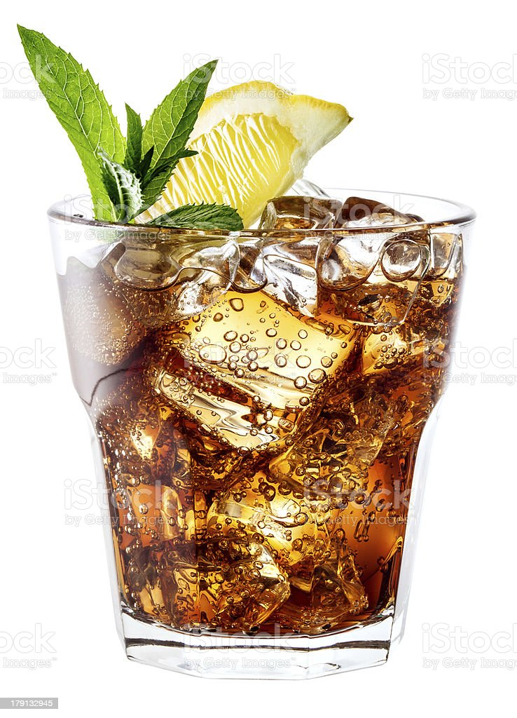 Glass of cola with ice, mint and lemon on white. royalty-free stock photo