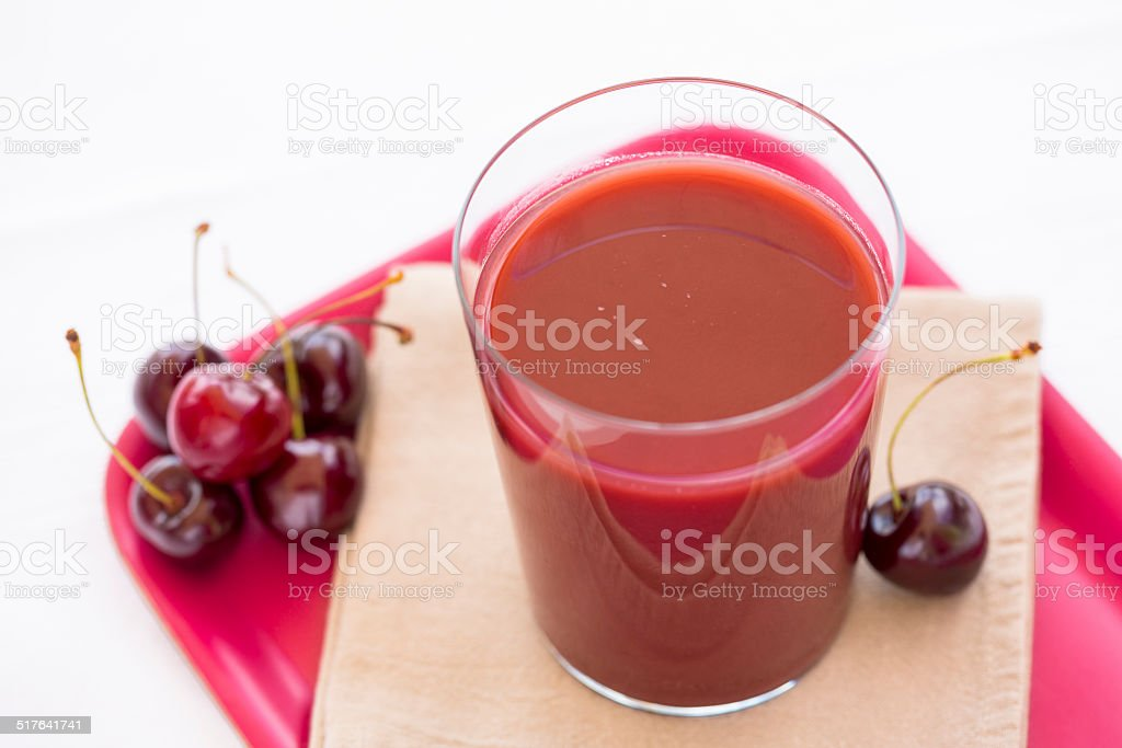 Glass of Cold cherry juice stock photo