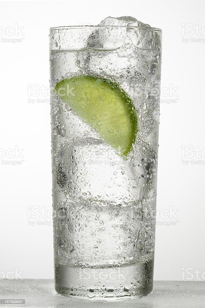 A glass of cold water with a slice of lime stock photo