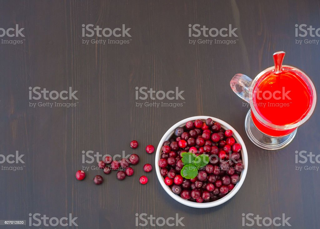Glass of cranberry juice and a bowl of cranberries stock photo