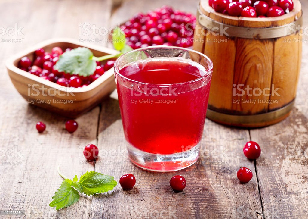 glass of cranberry juice with fresh berries stock photo