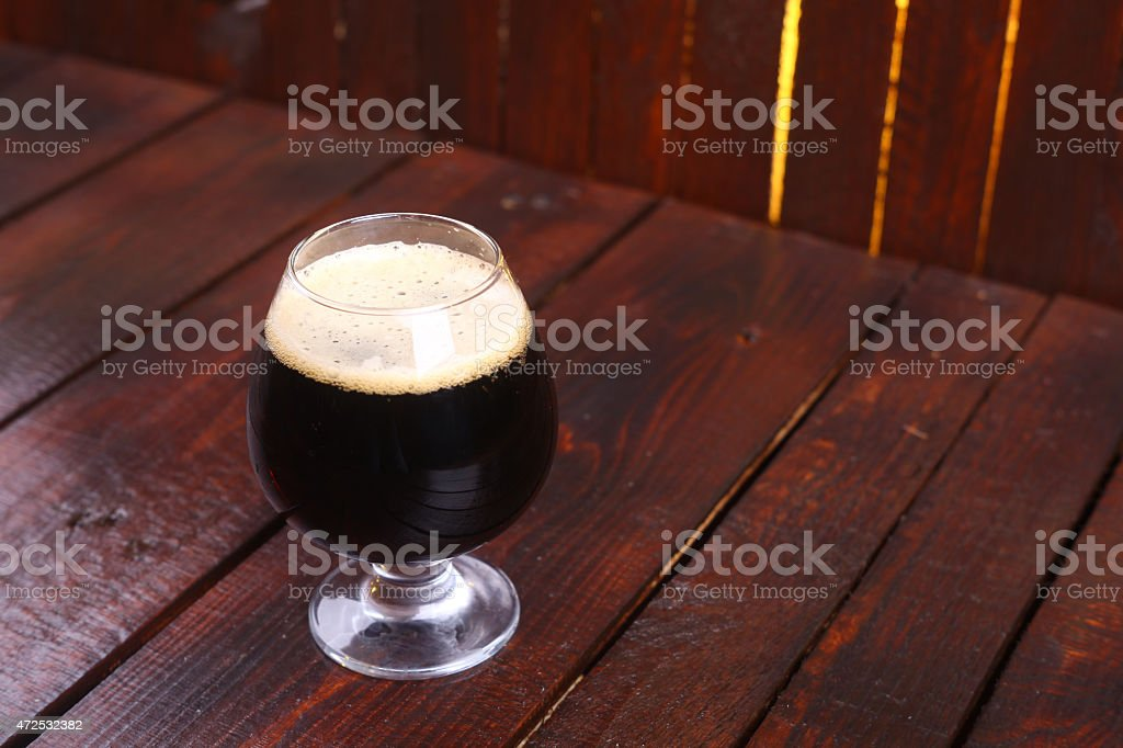 Glass of dark stout stock photo