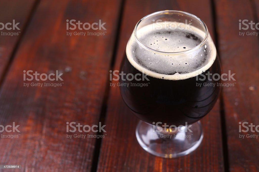 Glass of dark stout stock photo