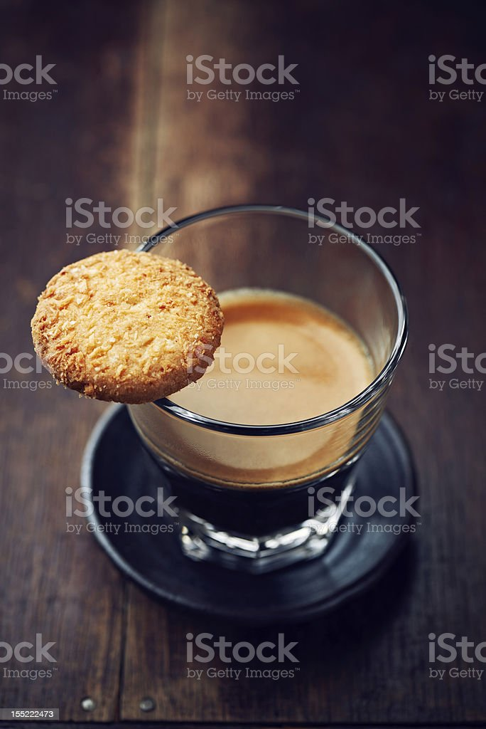 Glass of espresso and biscuit royalty-free stock photo
