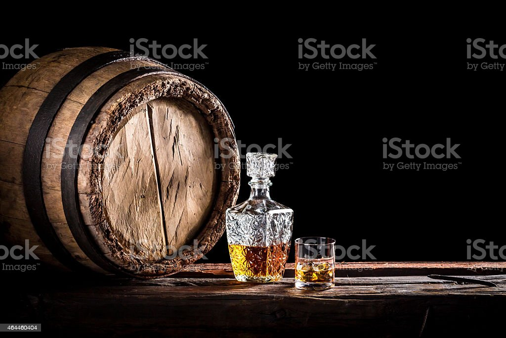 Glass of fine whisky in the distillery basement stock photo