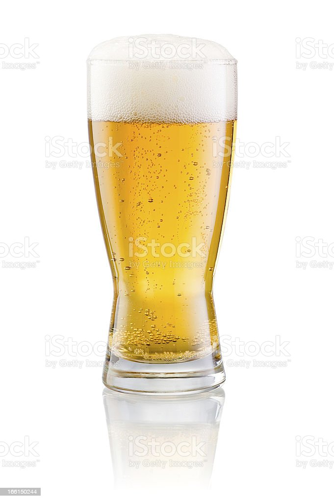 Glass of fresh beer with cap foam isolated on white stock photo