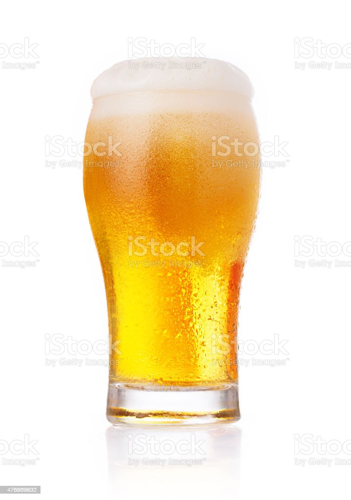Glass of fresh beer with cap of foam isolated on white. stock photo