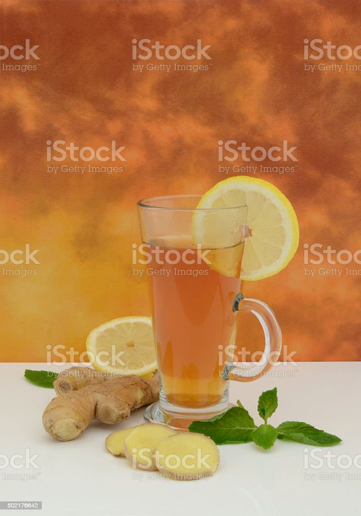 Glass of Fresh Ginger and Lemon Tea stock photo