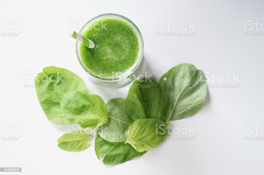 glass of fresh green spinach healthy smoothie stock photo