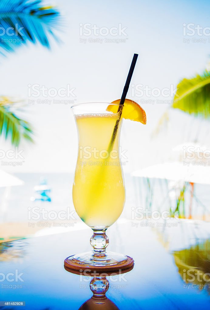 Glass of fresh Lime juice by the sea back lit stock photo